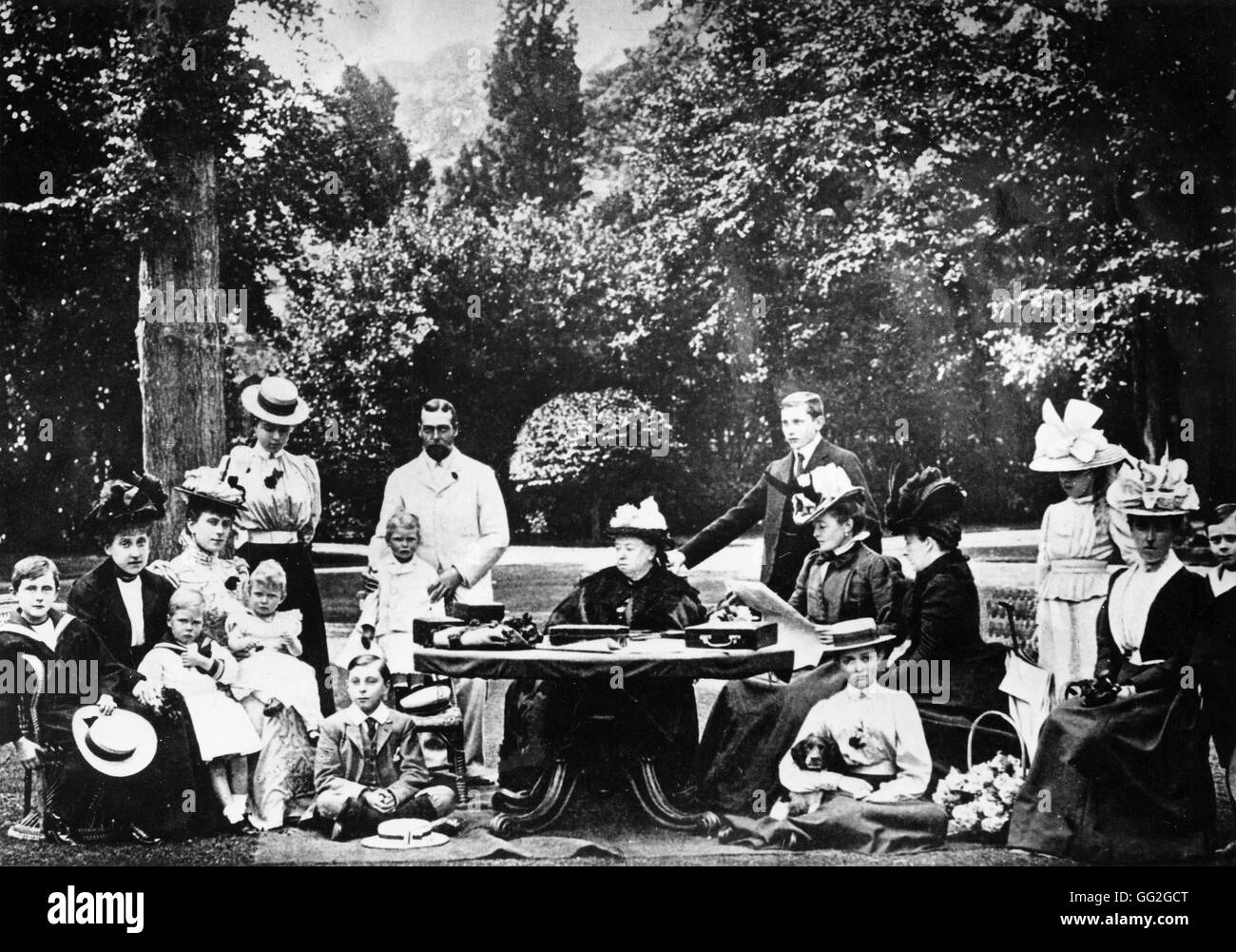 Queen Victoria surrounded by her entire family at Osborne House. Prince George's wife Mary has the Princess - Stock Image