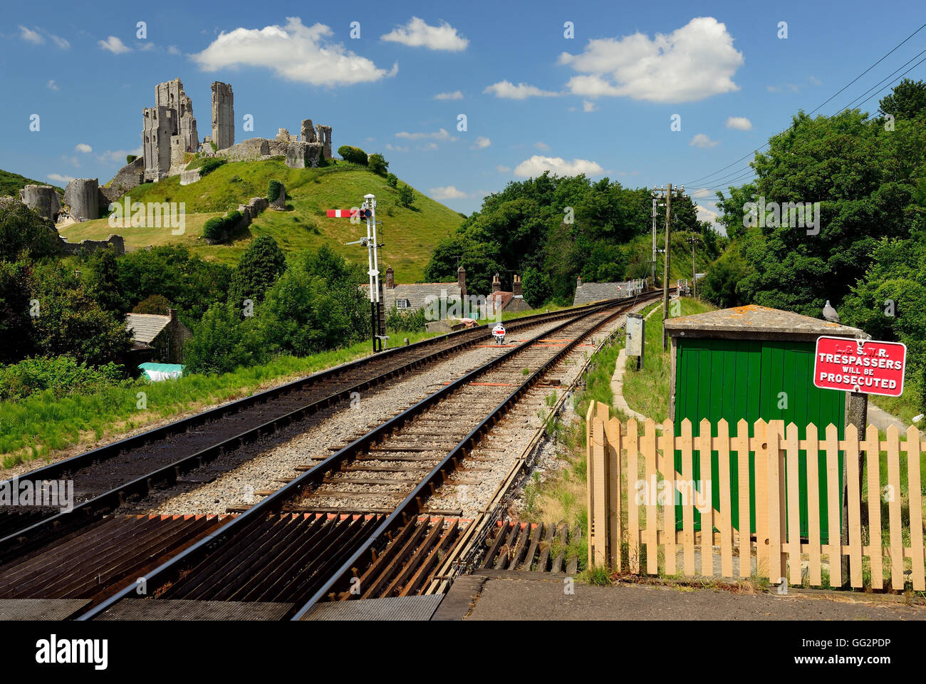 Corfe Castle beside the Swanage Railway. (Seen from the station platform). - Stock Image