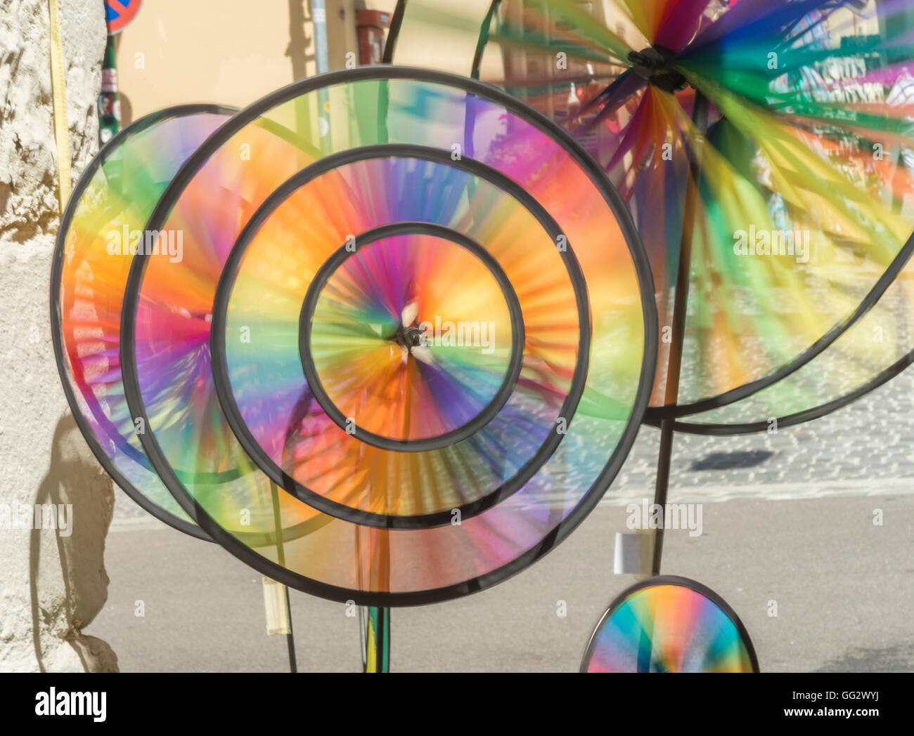 Closeup of spinning colored wind wheels outdoor - Stock Image
