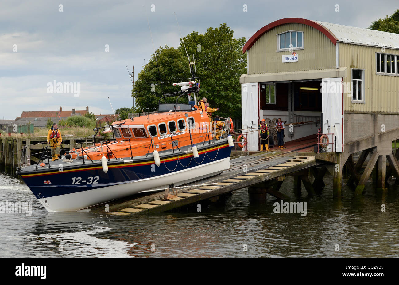 Recovering a Mersey class lifeboat from Berwick Lifeboat Station in the mouth of the River Tweed, - Stock Image