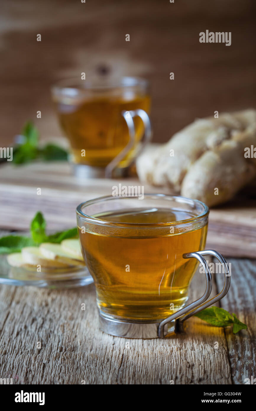 Hot ginger and mint tea, homemade green tea health benefits - Stock Image