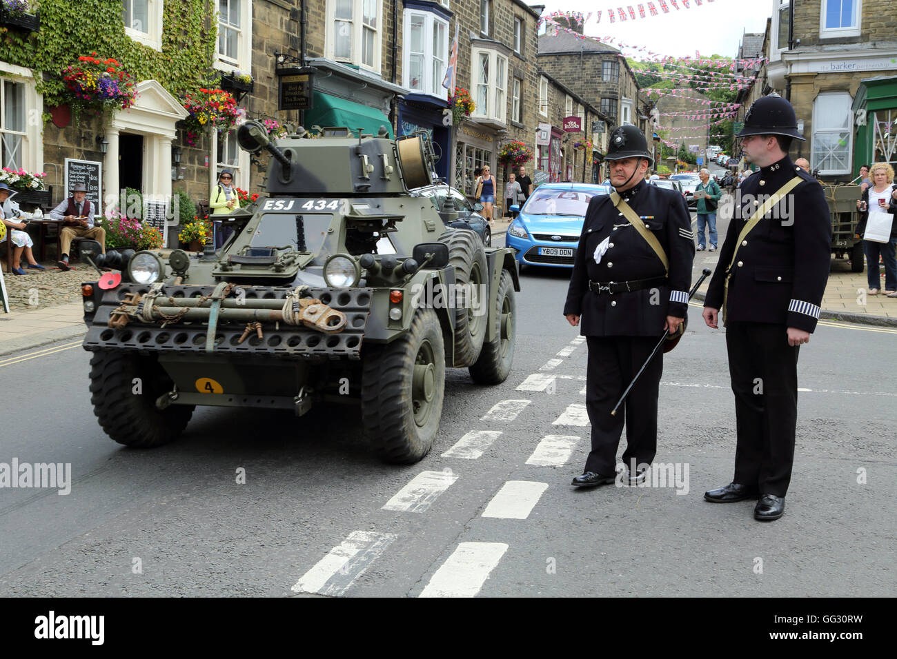 Armoured car and policemen as part of the 1940s weekend in High Street, Pateley Bridge, North Yorkshire, England, United Kingdom Stock Photo