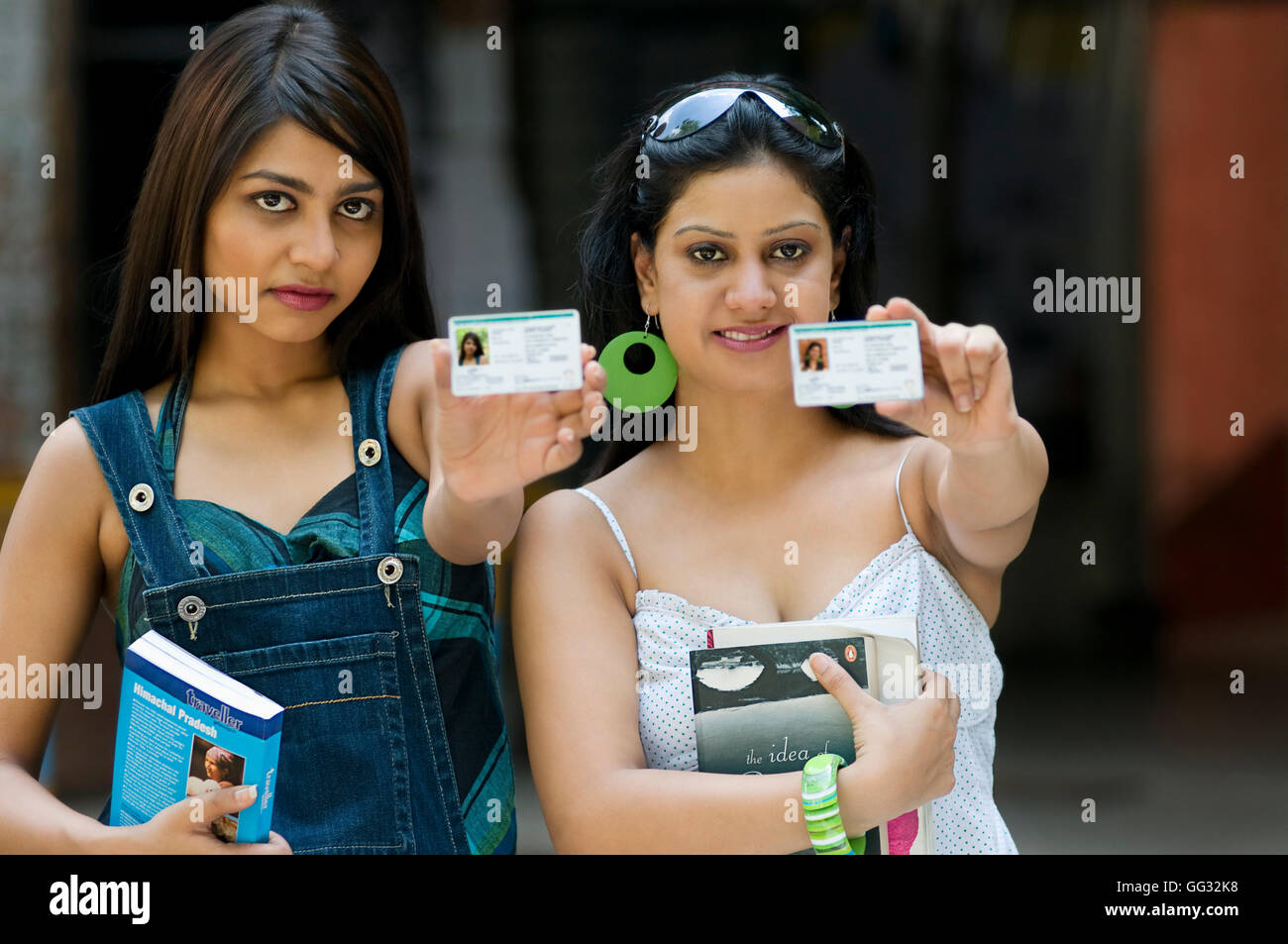 College students with identity cards - Stock Image