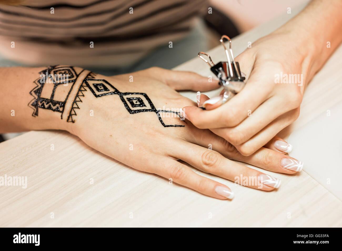 Artist Applying Henna Tattoo On Women Hands Mehndi Is Traditional