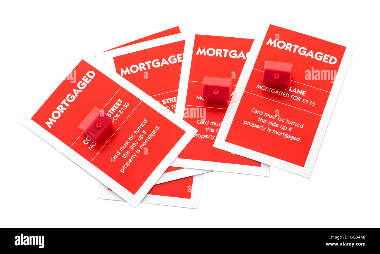 English Edition of Monopoly showing mortgage cards on a white background - Stock Image
