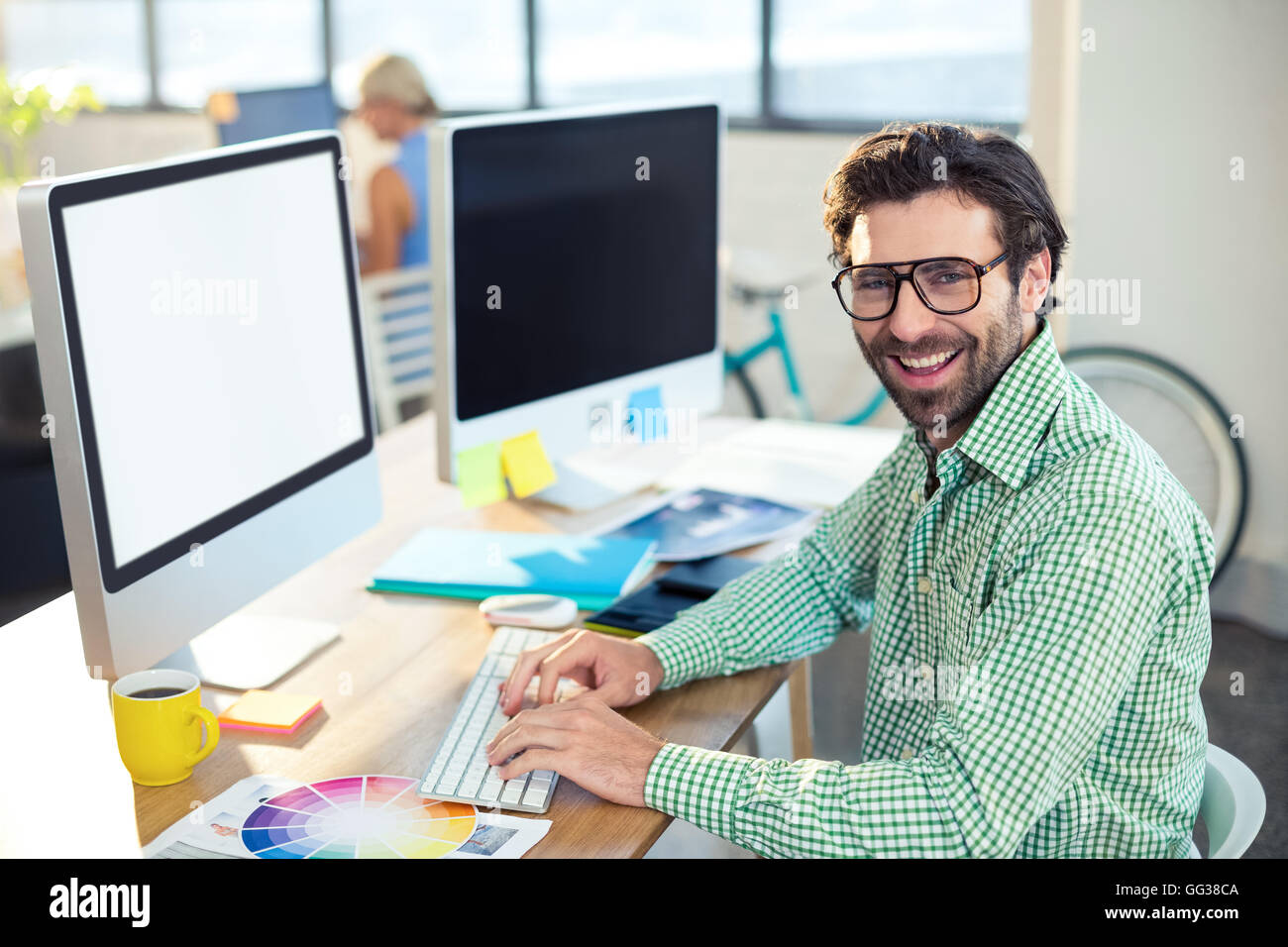 Graphic designer working on computer - Stock Image