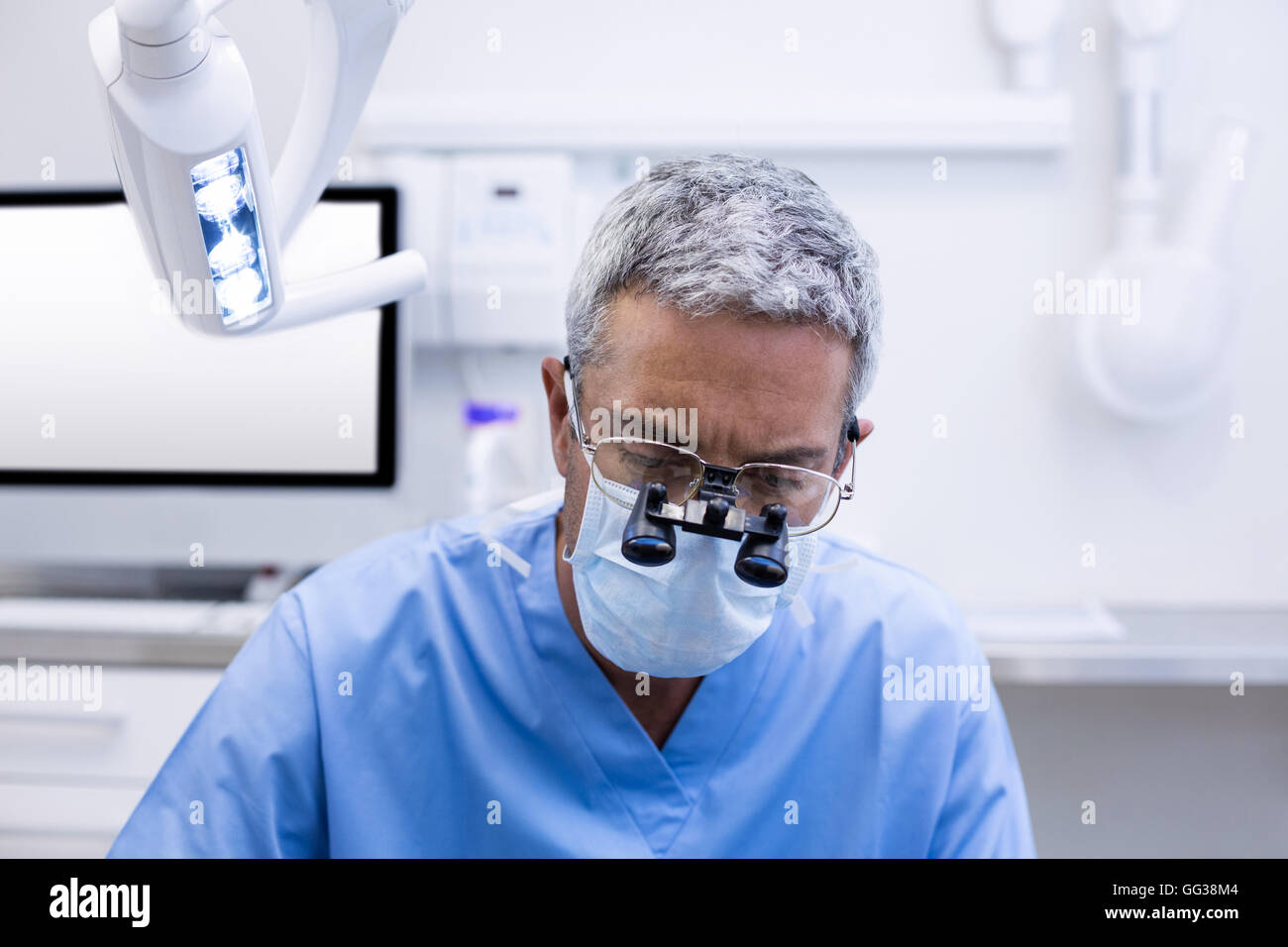 Dentist with surgical loupes - Stock Image