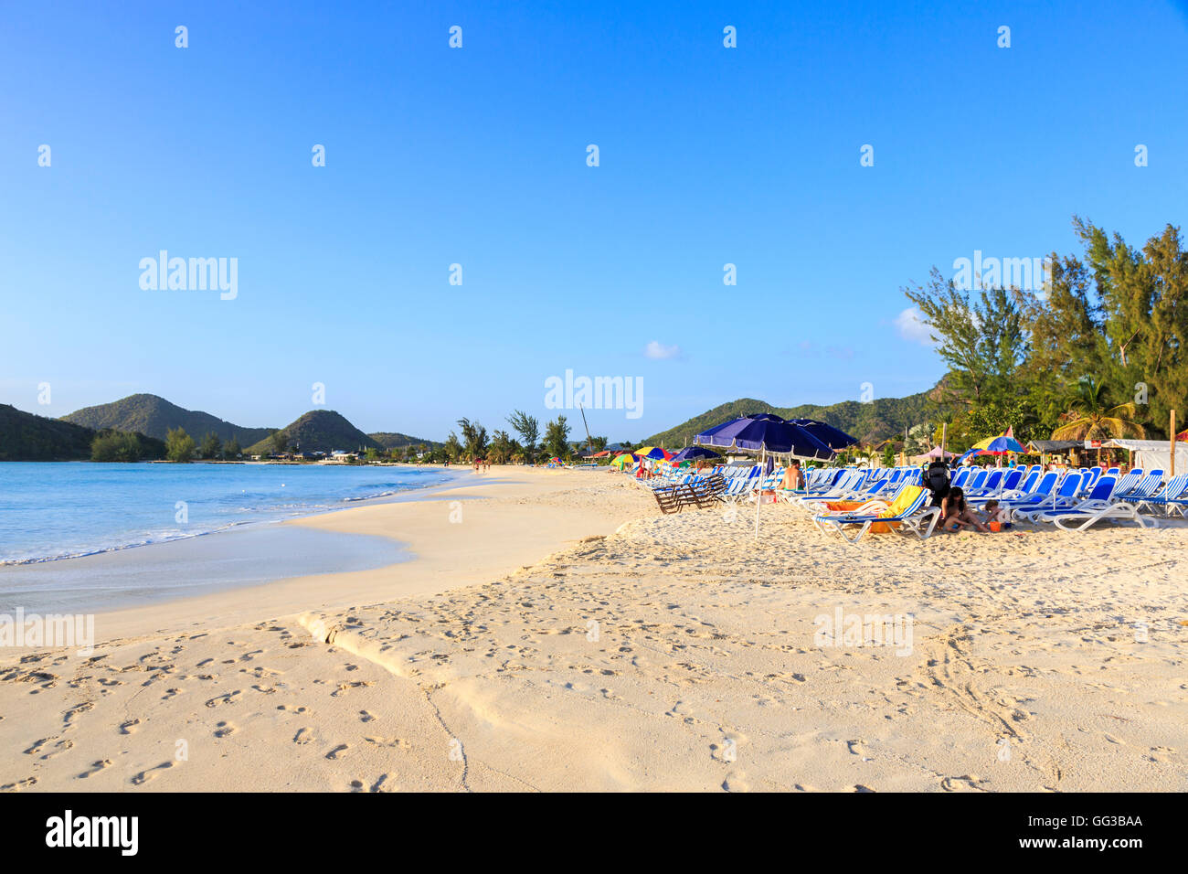 Golden sand beach at Jolly Harbour, south-west Antigua on a sunny day with blue sky - Stock Image
