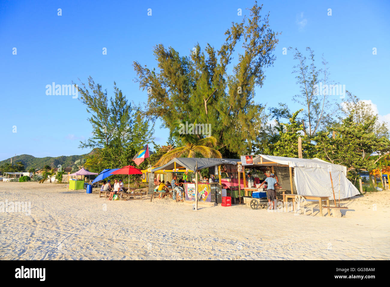 Local beach bar at Jolly Harbour, south-west Antigua on a sunny day with blue sky - Stock Image