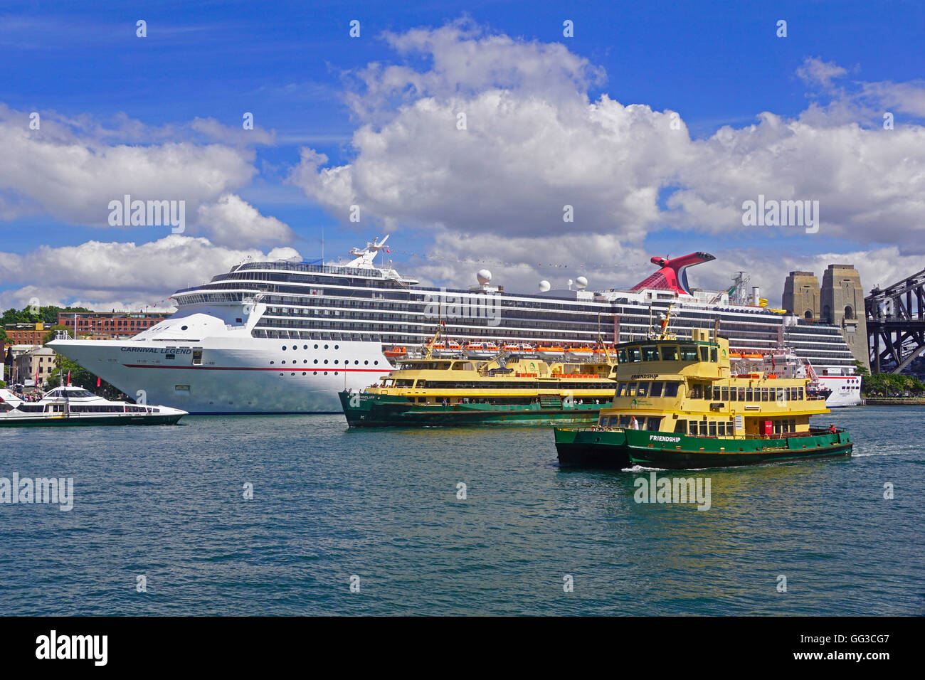 Carnival Legend cruise ship and Sydney Ferries in Sydney Harbour. - Stock Image