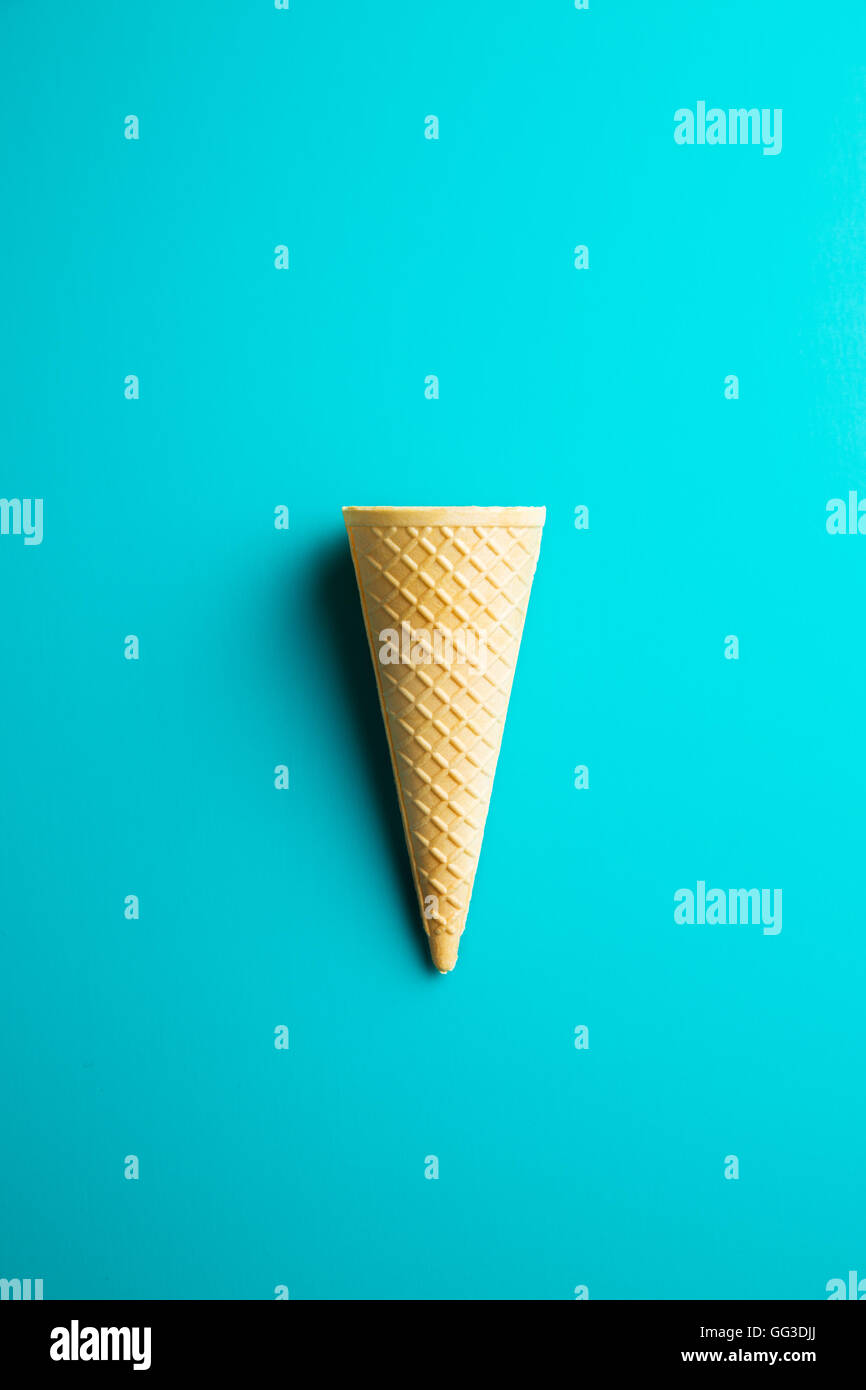 Sweet wafer cone on color background. Top view. Stock Photo