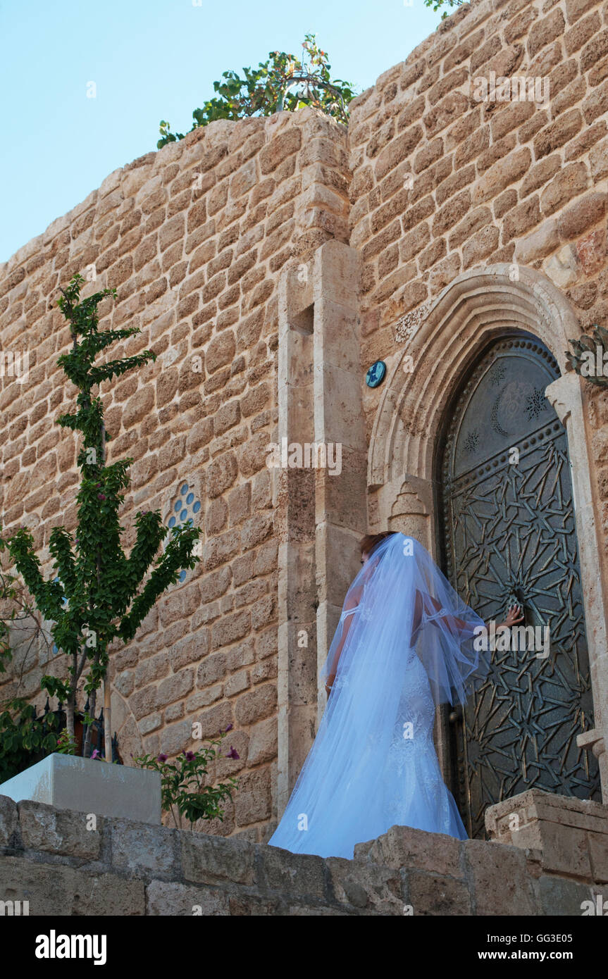 Jaffa, Israel, Middle East: a bride in the alleys of the Old City, chosen as perfect location for many weddings - Stock Image