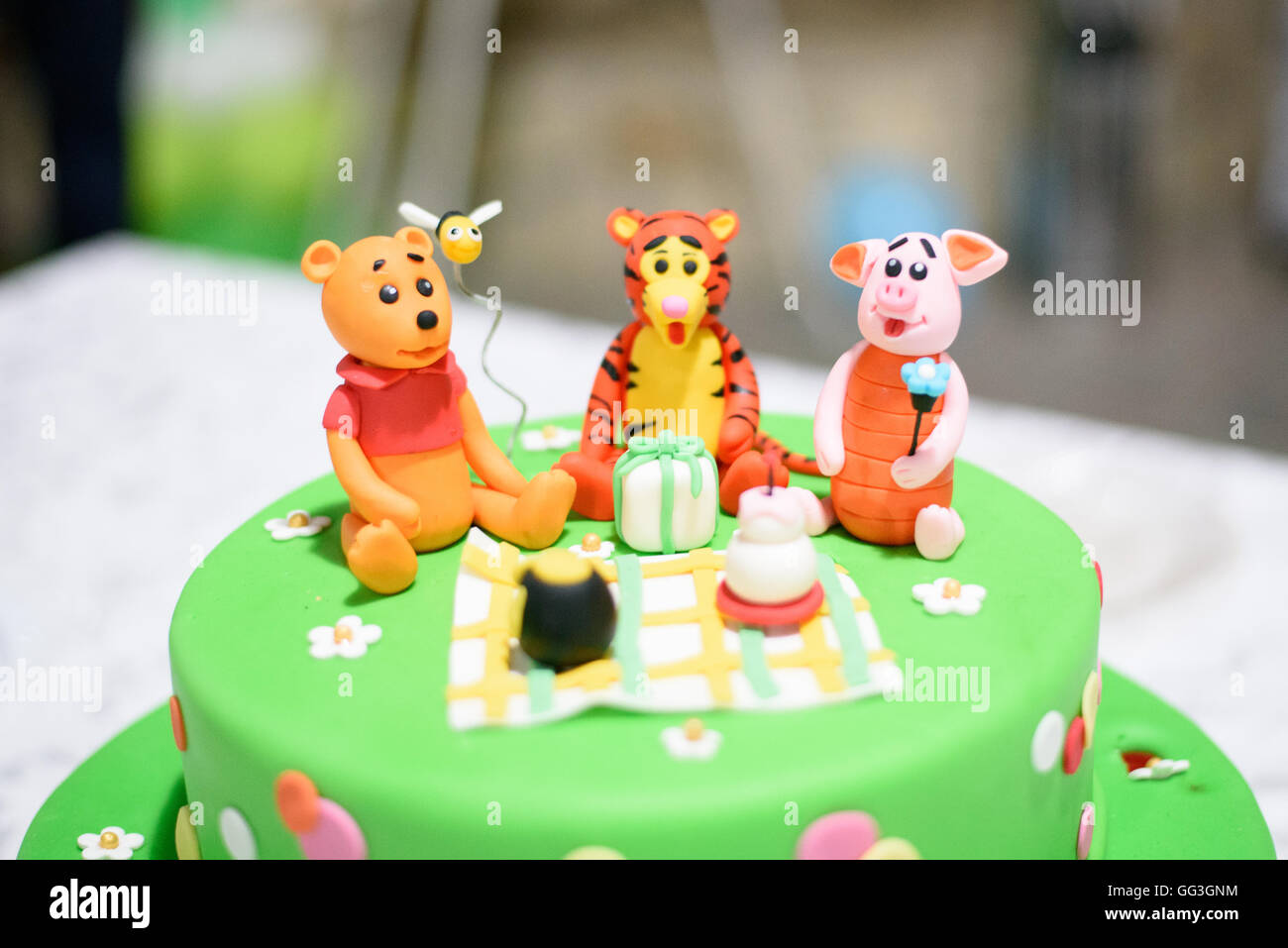 Birthday Cake With Candles And Winnie The Pooh By Disney Stock Photo