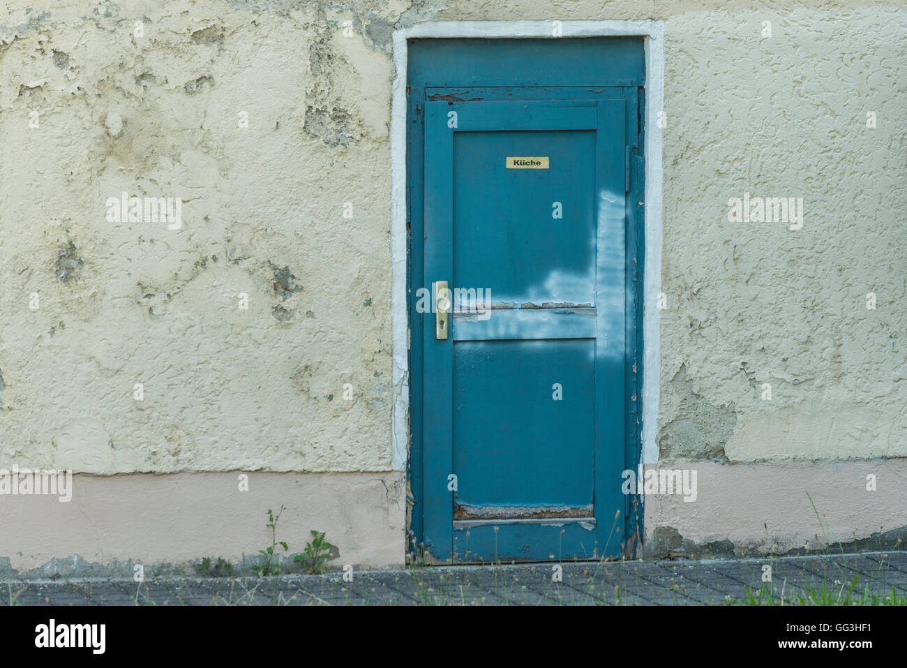 A old house with an door with german word for kitchen - Stock Image