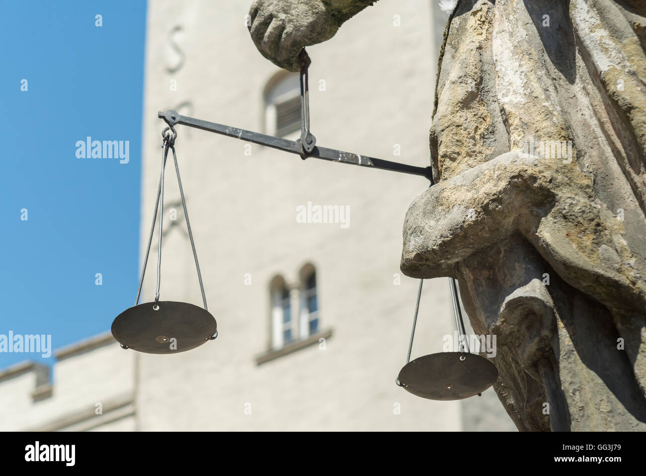 Closeup of the Justitia well in Regensburg with scales in her hands - Stock Image