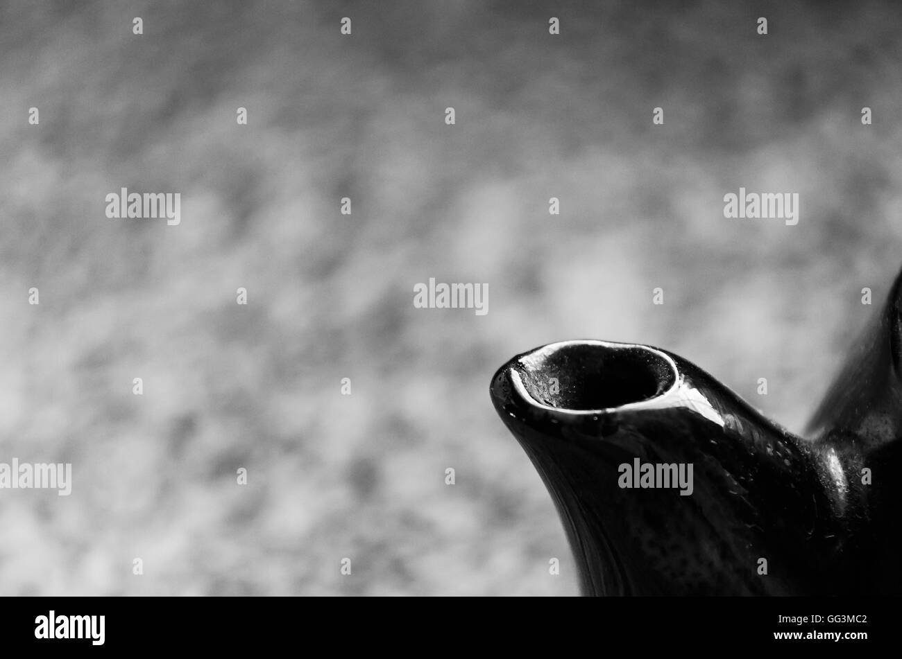 A teapot spout isolated on blurred background. - Stock Image