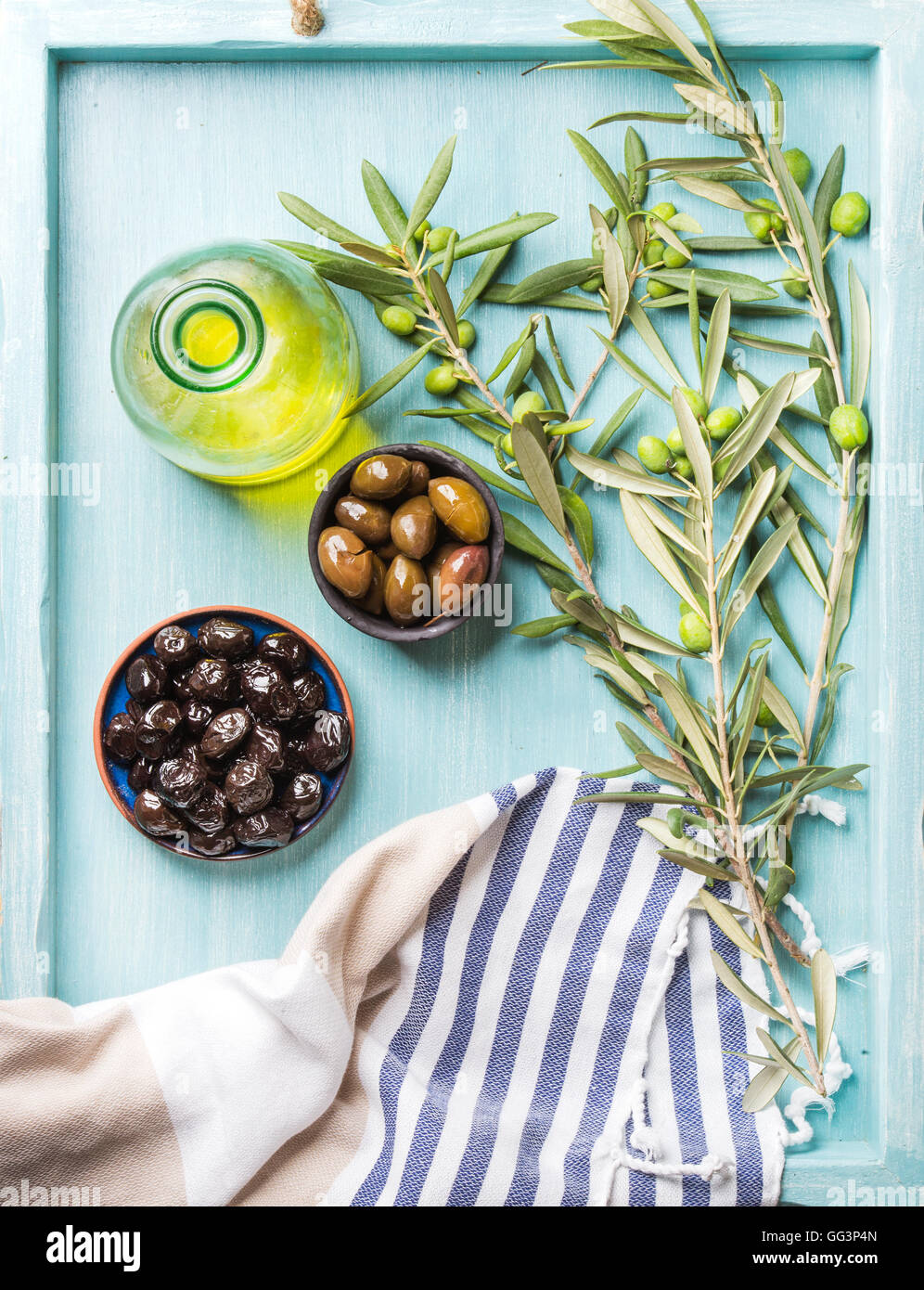 Green and black olives, olive tree sprigs - Stock Image