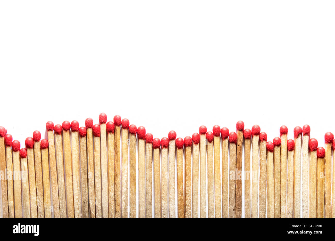many matches at the bottom of a photo on white background - Stock Image