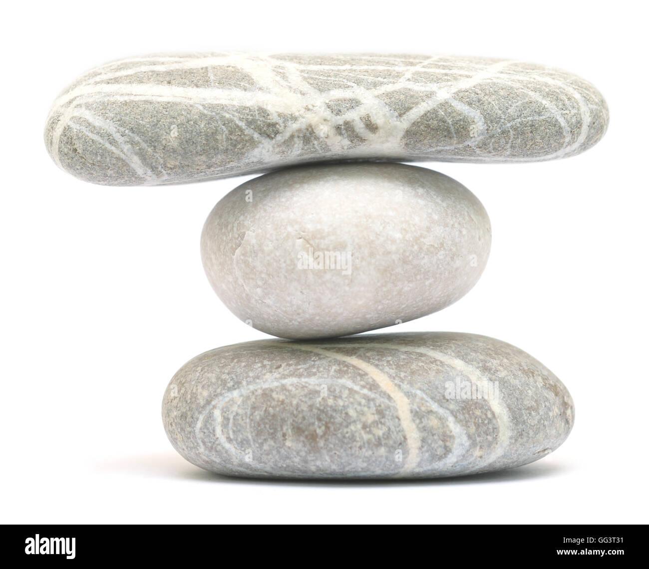 balancing stone tower isolated on white background - Stock Image