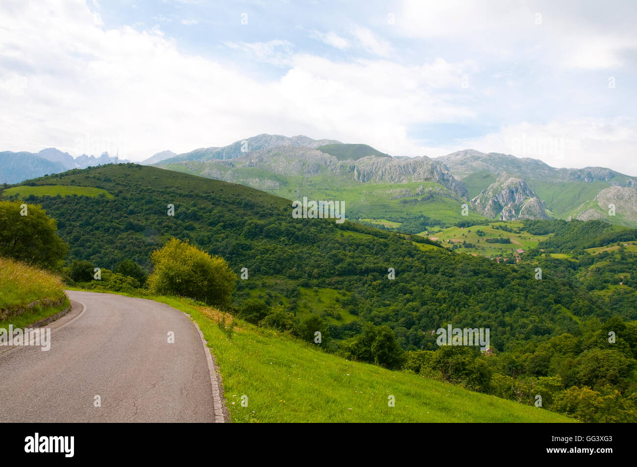 Side road and mountain landscape. Picos de Europa National park, Asturias, Spain. - Stock Image