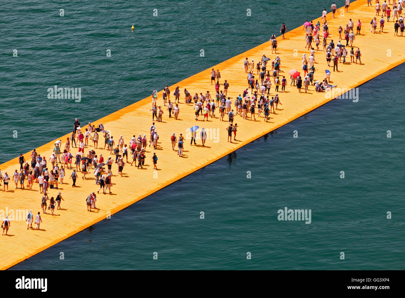 Floating Piers Project for Lake Iseo, Italy, by Christo and Jeanne-Claude. View from above of crowds on installation - Stock Image