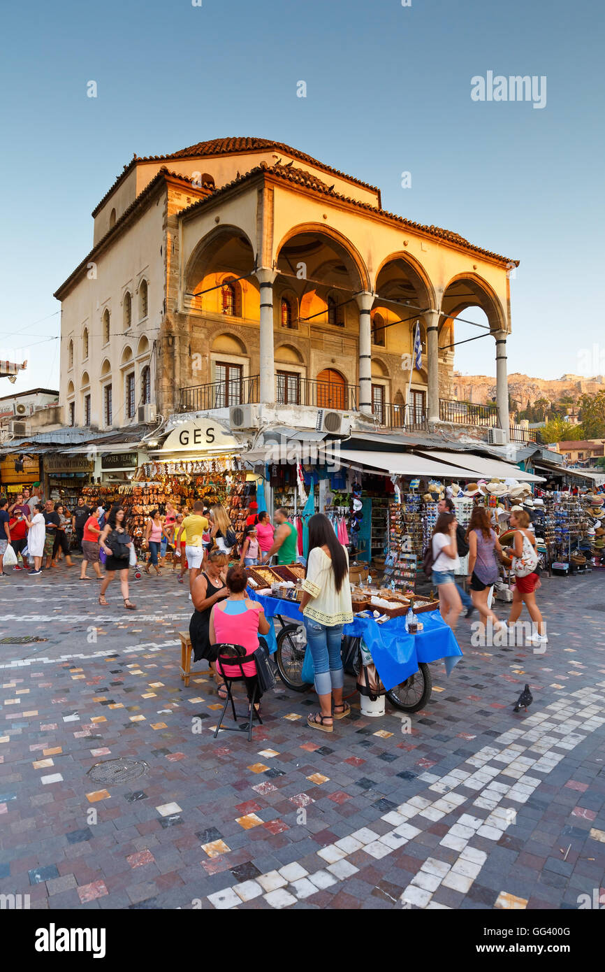Sweets sellers and tourists in front of the old mosque in Monastiraki square. - Stock Image