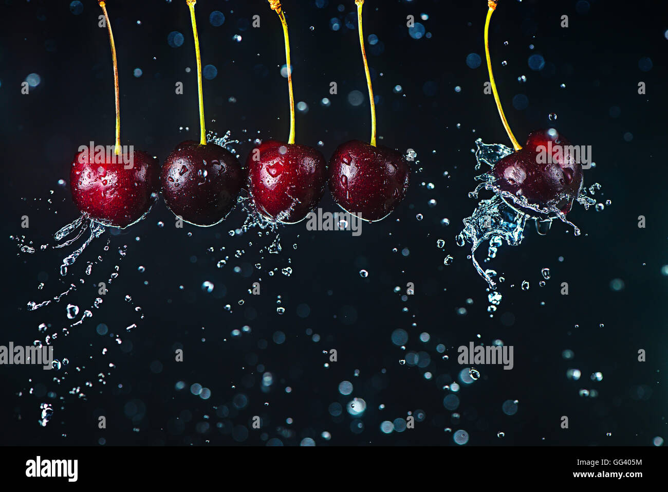 Newtons cradle (cherry version) - Stock Image