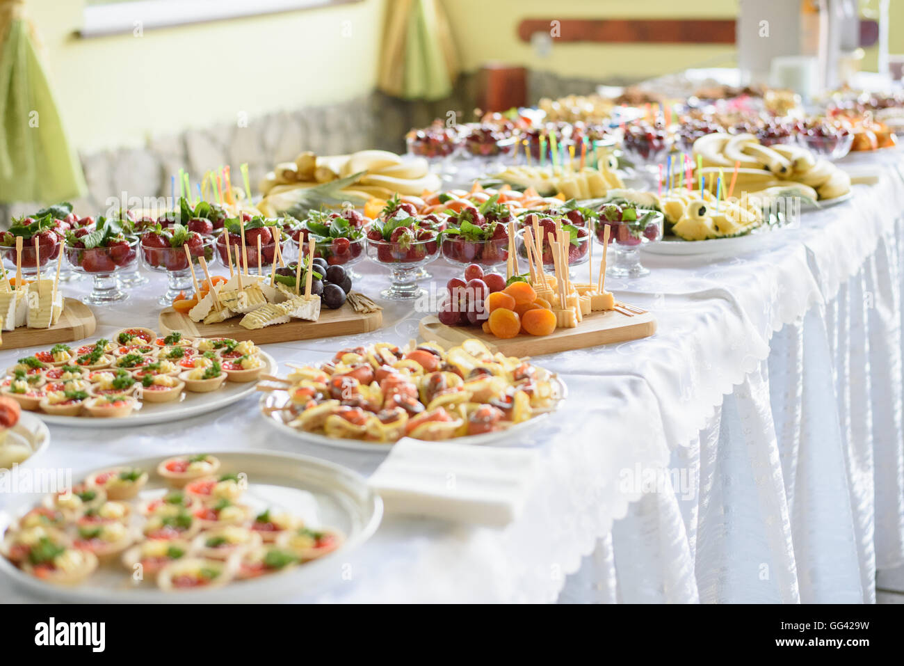 Catering and banquet wedding table setting on evening reception awaiting guests - Stock Image