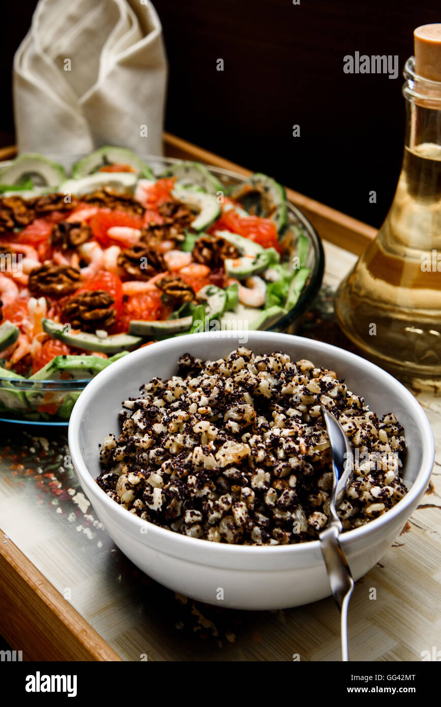boiled rice with raisins and honey with oil and salad - Stock Image