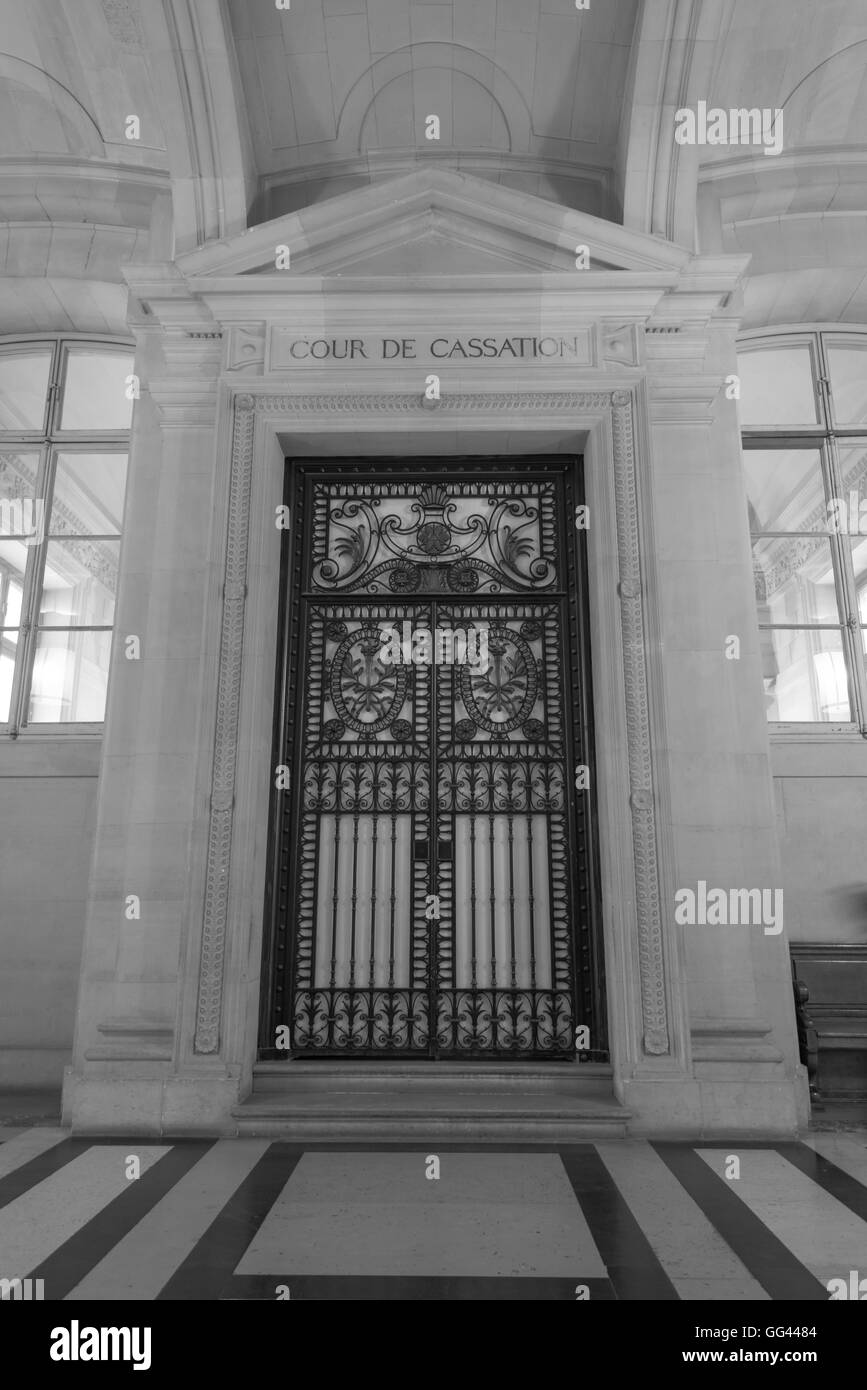 Black and white corridor of Paris courthouse with blurry lawyers, France - Stock Image