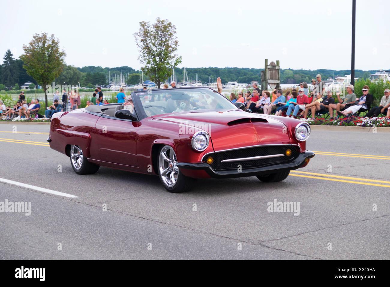 Remodeled 1950s era Mercury convertible participates in 2016 Annual Cruz In Parade through Montague, Michigan. Stock Photo