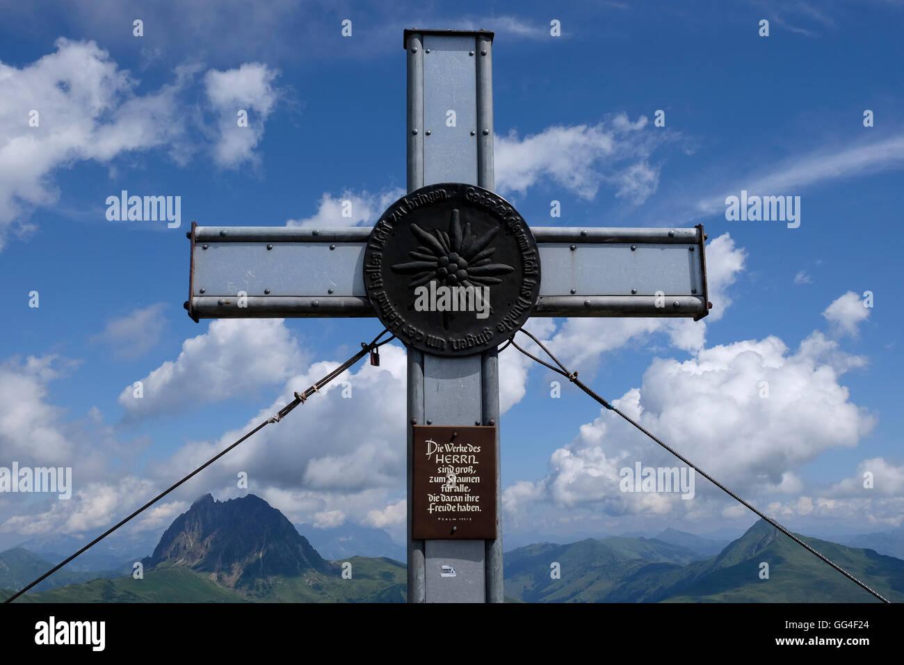 Summit cross in the Austrian alps. - Stock Image