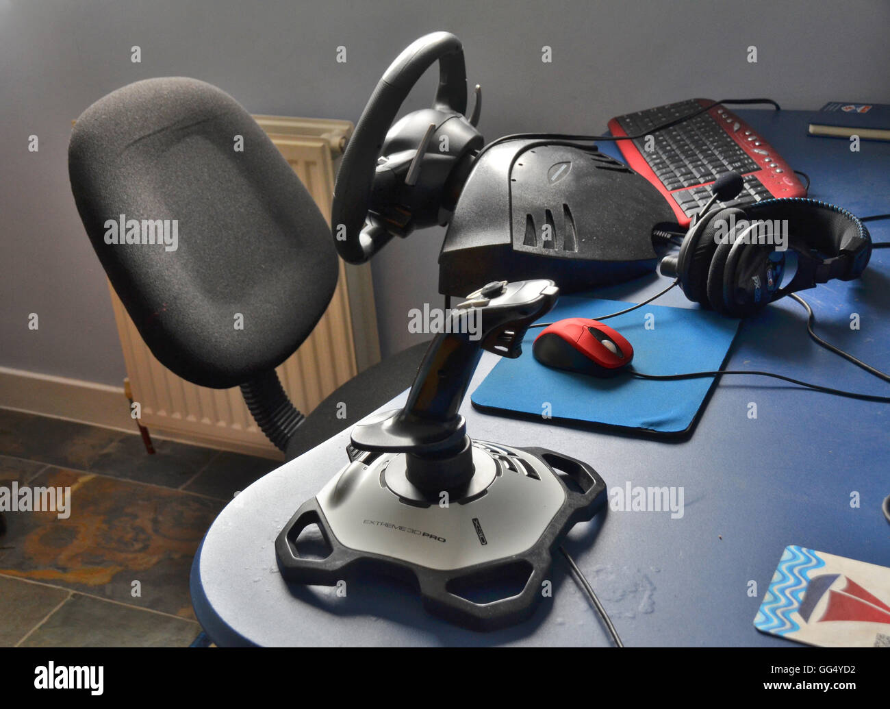 gaming rig, station, including accessories connected to the  PC,  such as joystick,headphones, mouse, keyboard  - Stock Image