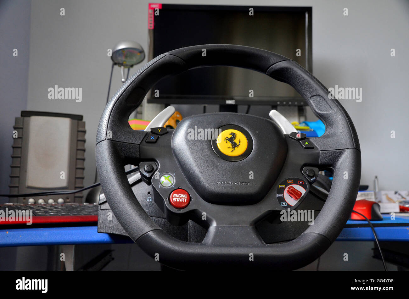 computer gaming rig - includes steering wheel assembled to desktop. monitor and speakers. - Stock Image