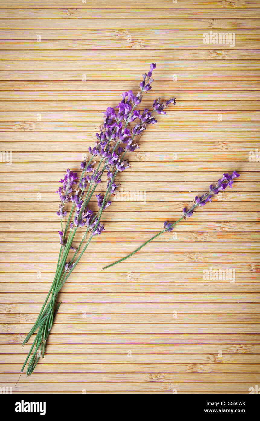 Lavender on wooden texture. Element of design. - Stock Image