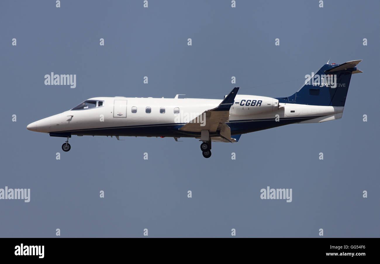 Learjet 55 Jet Executive approaching to El Prat Airport in Barcelona, Spain. - Stock Image