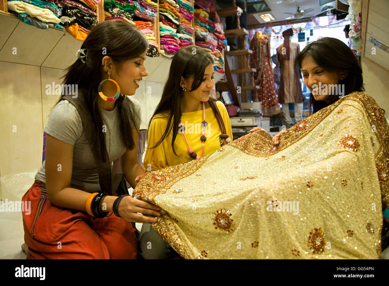 Girls at a garment shop Stock Photo