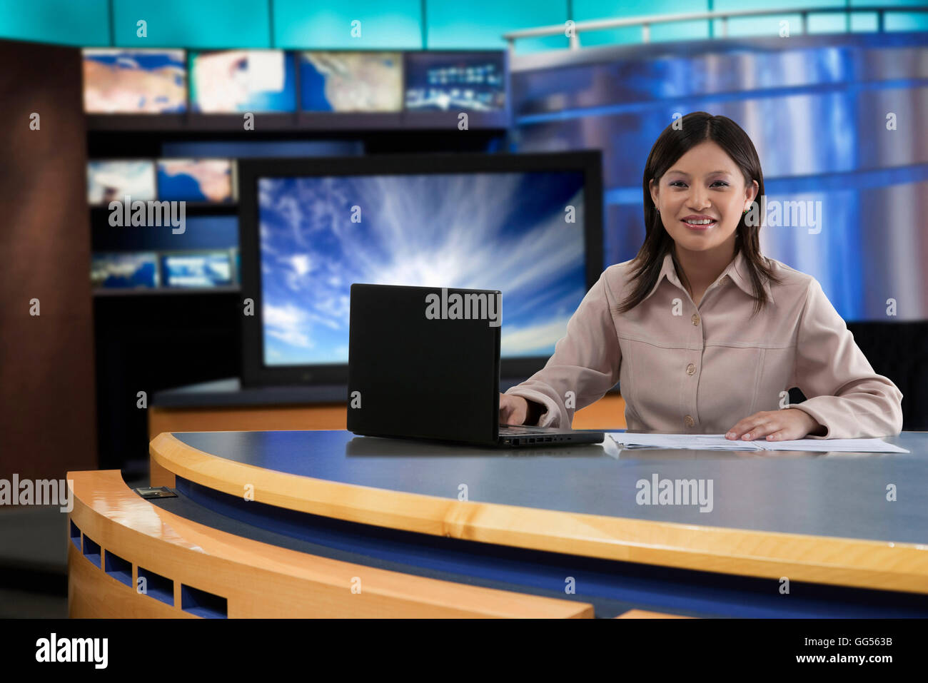 Portrait of female anchor in newsroom Stock Photo