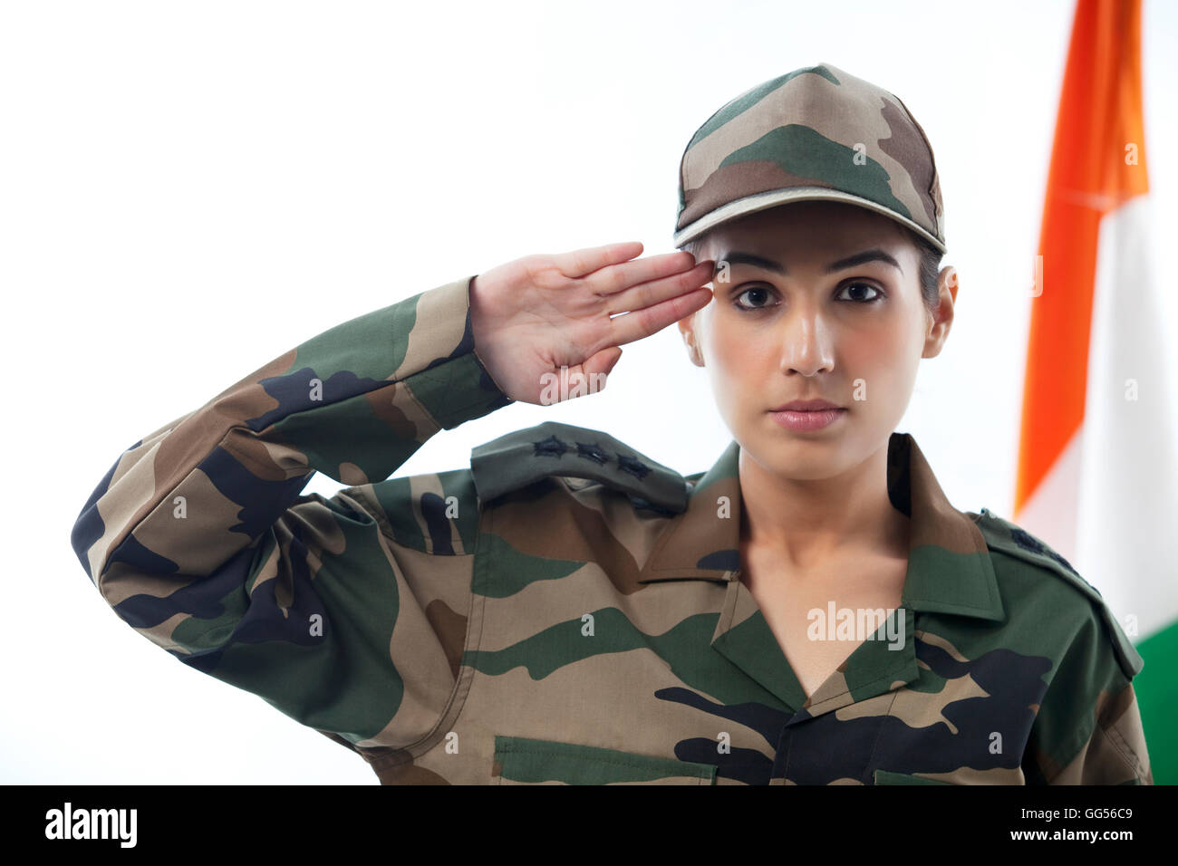 Female Sol R Saluting With Indian Flag In Background Stock Image