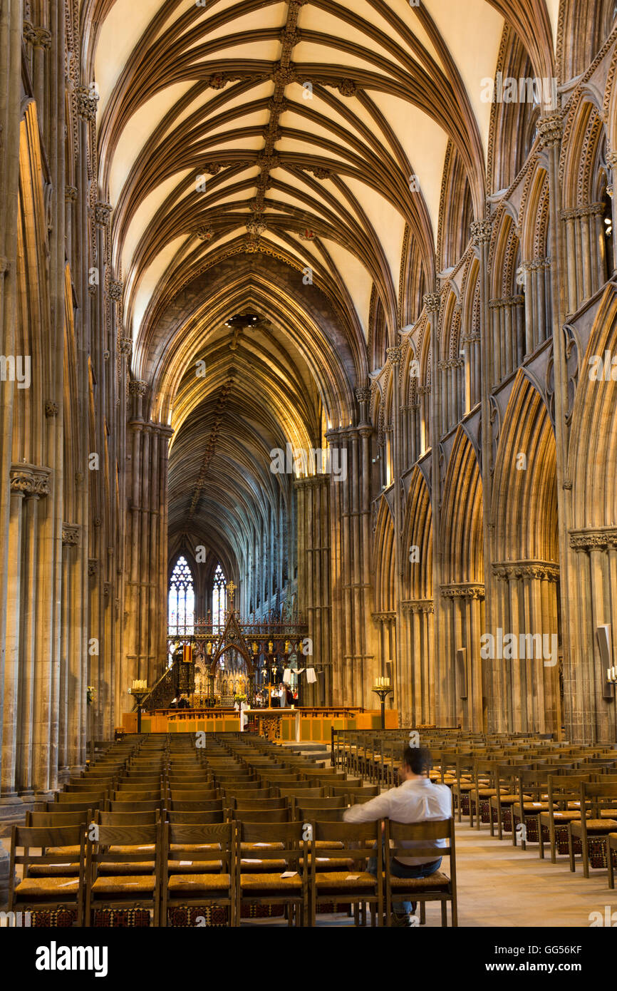UK, England, Staffordshire, Lichfield, Cathedral, Nave, man in rear pew - Stock Image