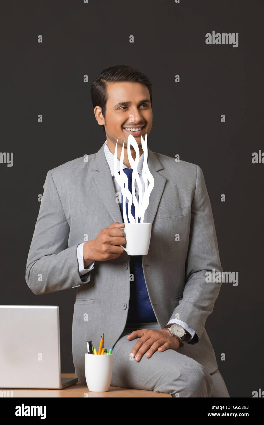 Digitally generated image of businessman having coffee in office Stock Photo