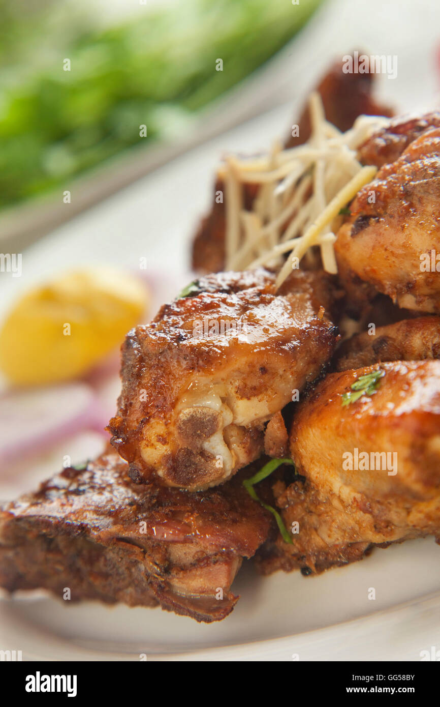 Close-up of fried chicken served in plate - Stock Image