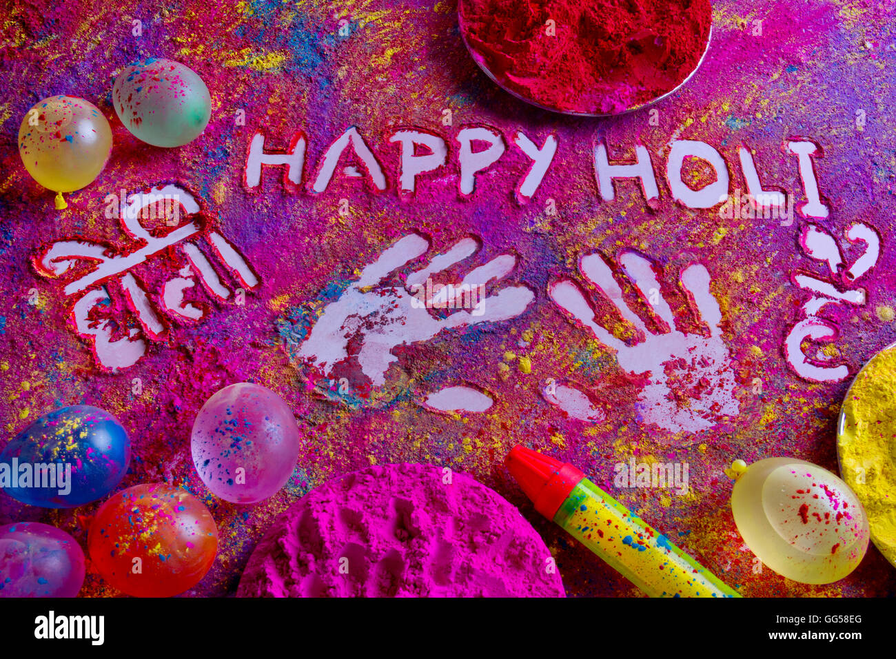 Squirt gun, water bombs and colorful power on rangoli - Stock Image