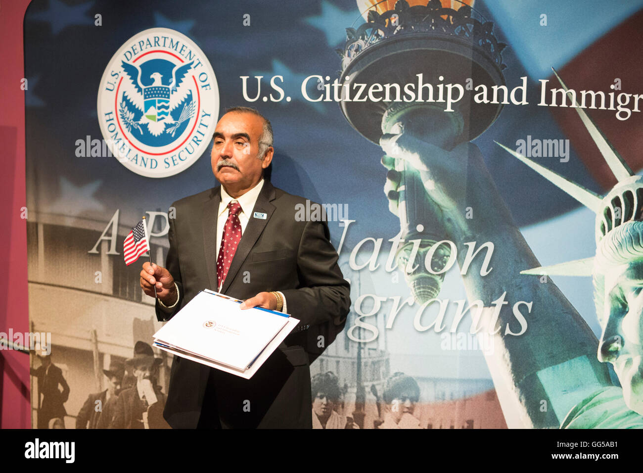 New United States citizen poses with certificate of naturalization during citizenship ceremony in San Antonio Texas - Stock Image