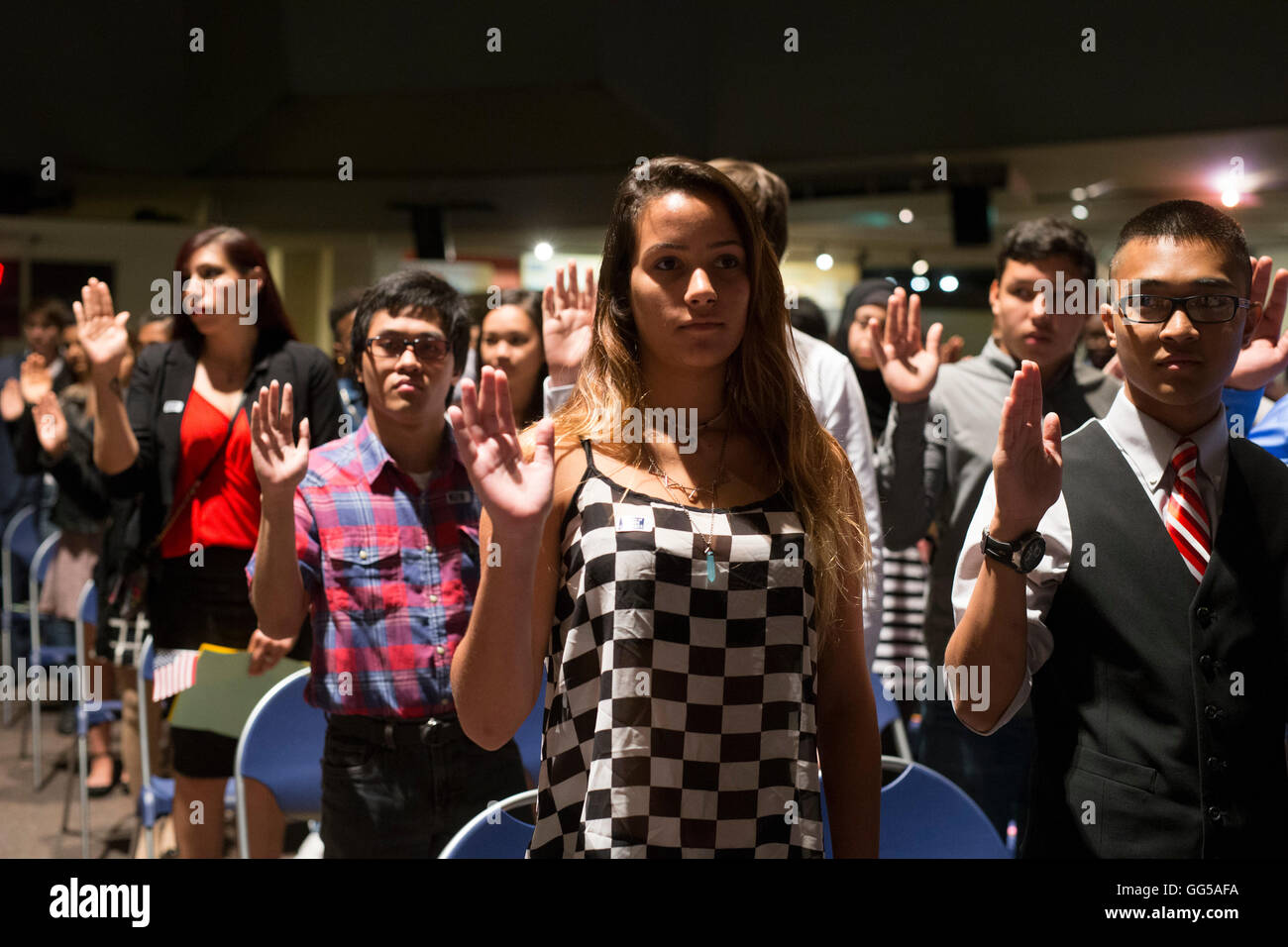 NNew United States citizens are sworn in during naturalization Stock