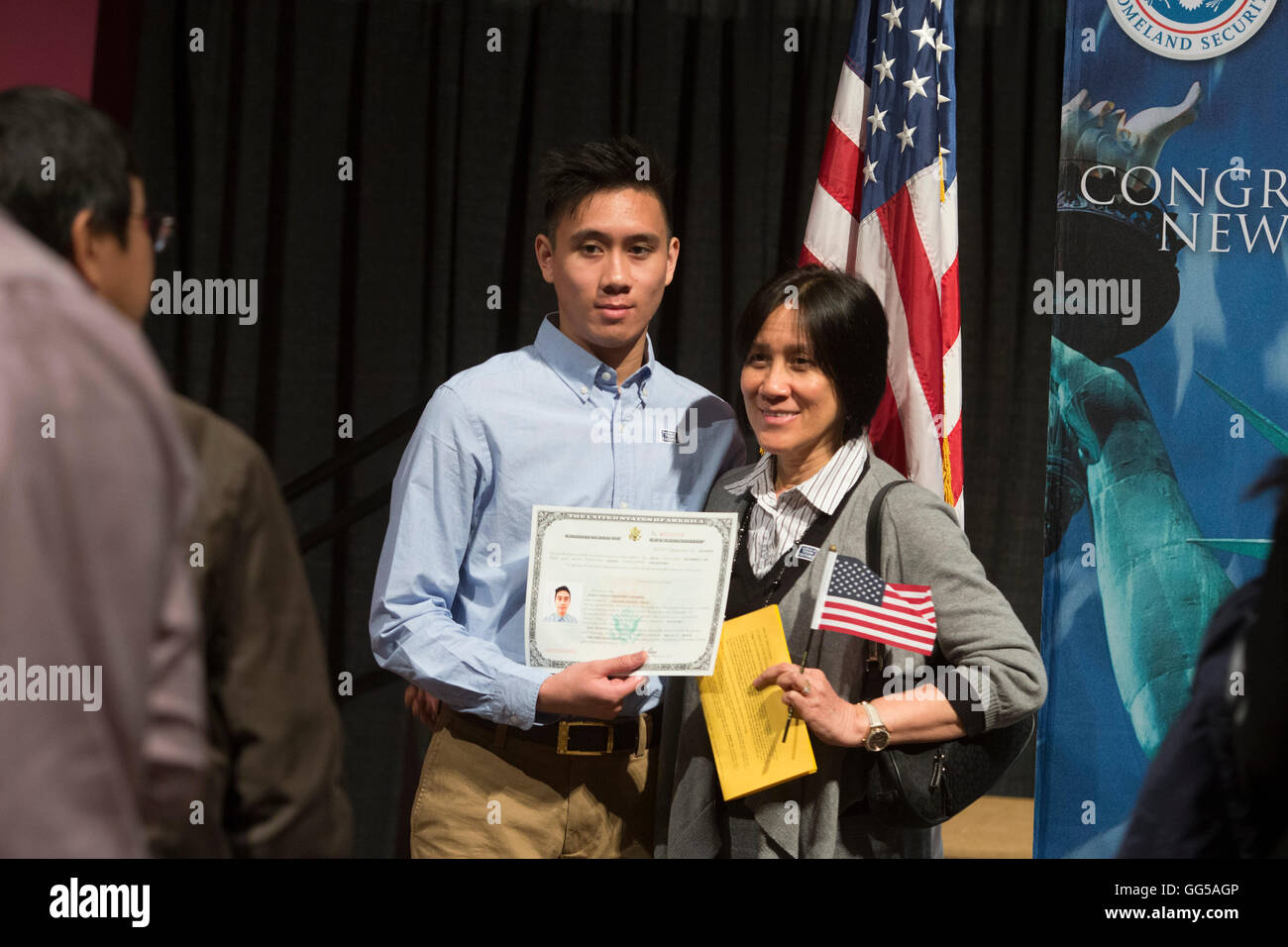New United States citizen poses with citizenship certificate