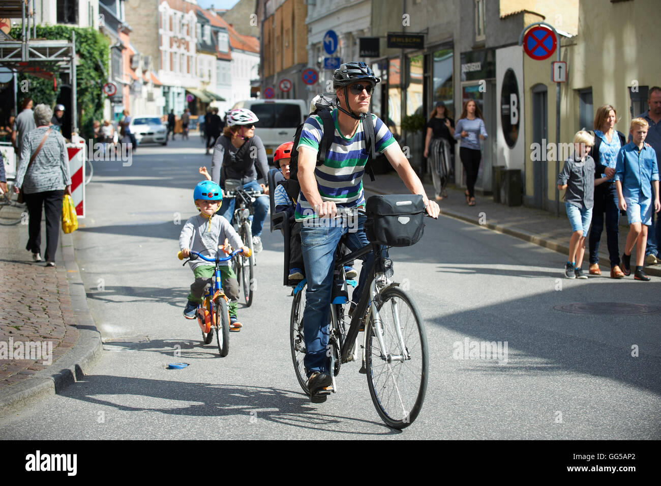 Cycling family in Graven, Aarhus City, Denmark - Stock Image