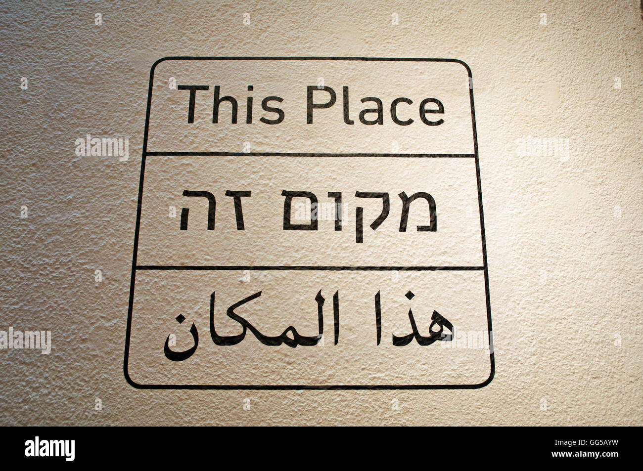 Israel, Middle East: the inscription This Place in English, Hebrew and Arab at the entrance of the Tel Aviv Museum - Stock Image