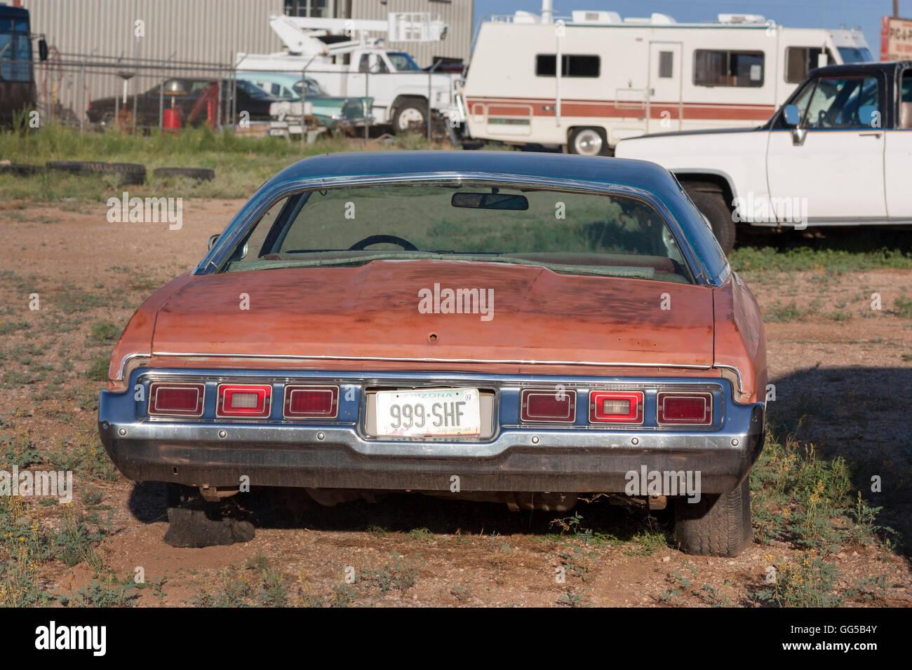 rusty classic American car in a junkyard Route 66 near Kingman Stock ...