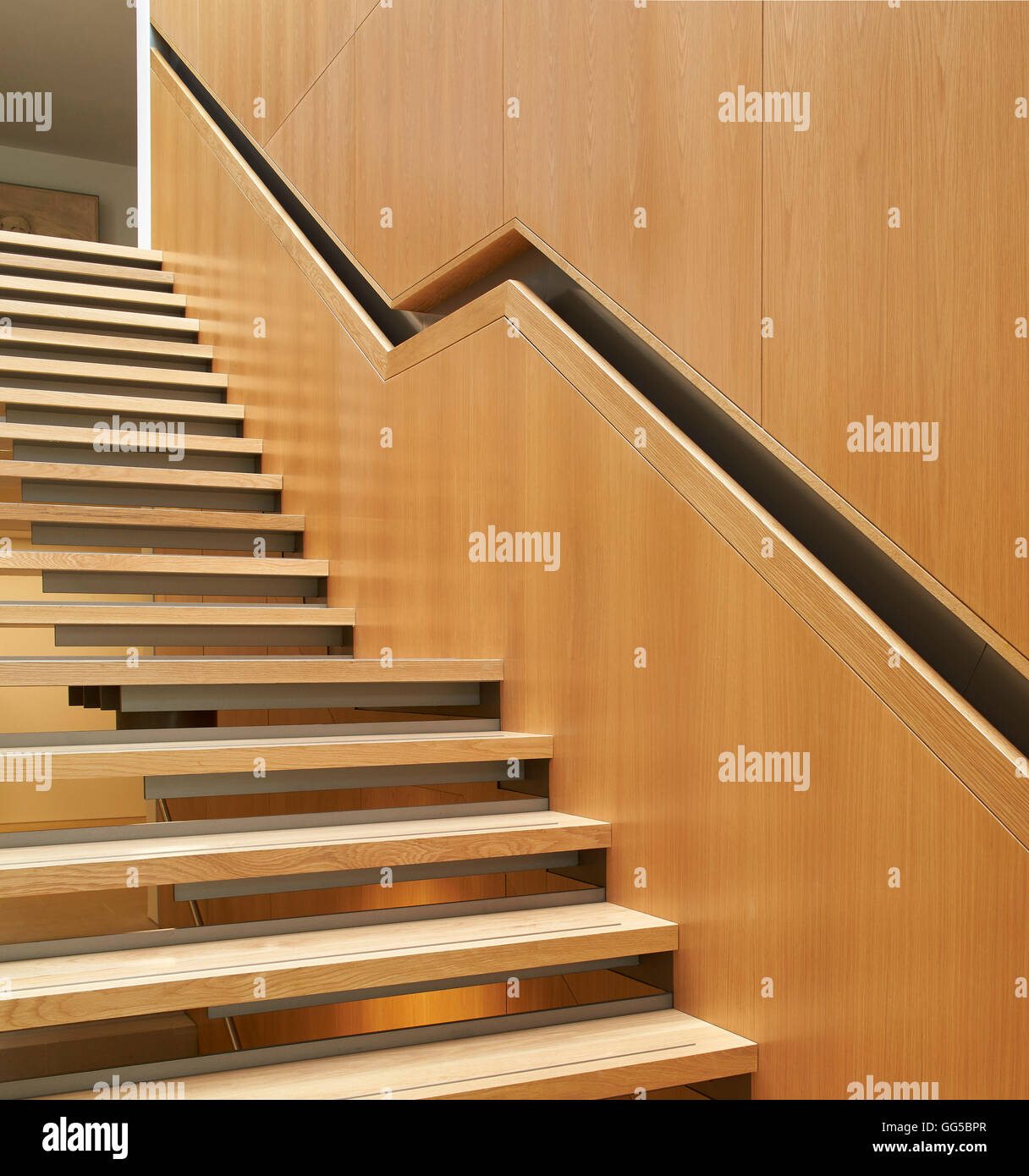 Timber stairway with recessed handrail. The Garden Building  at Lincoln College, Oxford, United Kingdom. Architect: - Stock Image